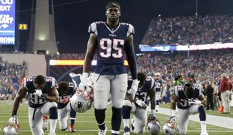 """FILE - In this Oct. 29, 2015 file photo, New England Patriots defensive end Chandler Jones walks in the end zone before an NFL football game against the Miami Dolphins in Foxborough, Mass. Jones was admitted to a hospital on Sunday, Jan. 10, 2016, and released the same day, the team said in a statement that did not elaborate on the nature of the medical issue. """"He reported to work on time Monday morning and has participated in all meetings and practices since then,"""" the report said. (AP Photo/Michael Dwyer, File)"""