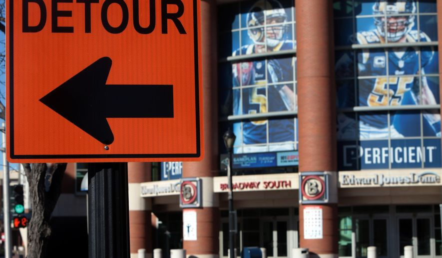 A detour sign for Riverfront construction stands in front of the Edwards Jones Dome on Tuesday, Jan. 12, 2016, in St. Louis. The St. Louis Rams are moving back to Los Angeles and the San Diego Chargers will have the option to join them in a compromise approved by NFL owners Tuesday night. (Laurie Skrivan/St. Louis Post-Dispatch via AP) EDWARDSVILLE INTELLIGENCER OUT, THE ALTON TELEGRAPH OUT