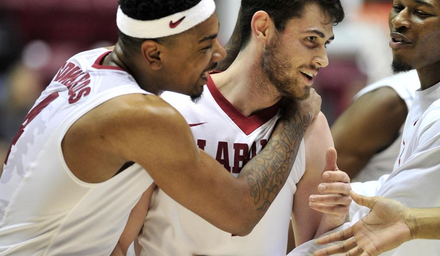 Alabama forward Riley Norris (1) is congratulated after a three-pointer over the South Carolina Gamecocks during the first half of an NCAA college basketball game, Wednesday, Jan. 13, 2016, in Tuscaloosa, Ala. (AP Photo/Eric Schultz)