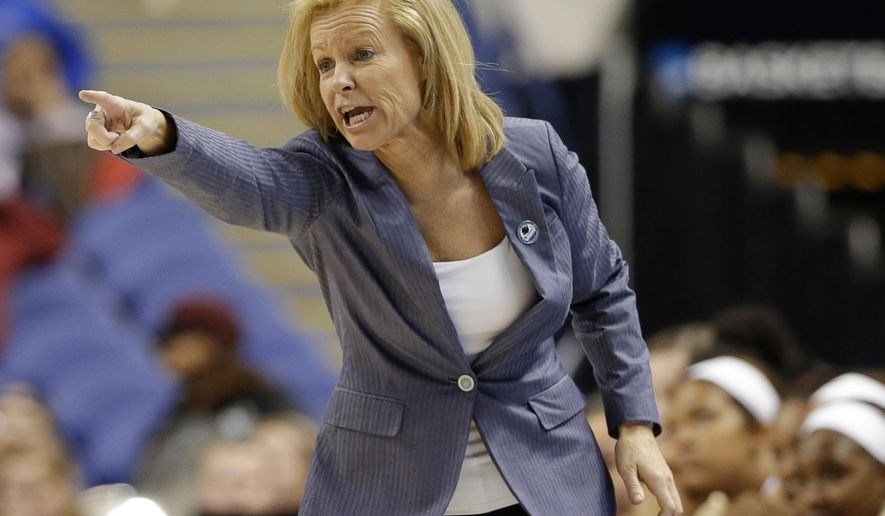 FILE - In this March 27, 2015, file photo, Florida State coach Sue Semrau directs her team during the first half of a regional semifinal against Arizona State in the NCAA college basketball tournament in Greensboro, N.C. For the first time in the 701 weeks of The Associated Press women's basketball poll, four teams from Florida: Florida State, South Florida, Florida and Miami are ranked in the Top 25. (AP Photo/Gerry Broome, File)
