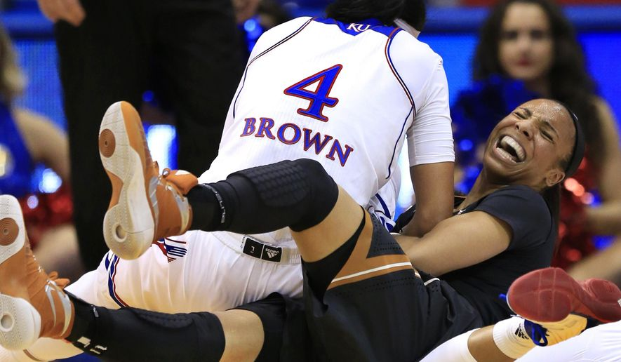 Texas guard Brianna Taylor, right, scrambles for the ball with Kansas forward Jada Brown (4) during the second half of an NCAA college basketball game in Lawrence, Kan., Wednesday, Jan. 13, 2016. (AP Photo/Orlin Wagner)