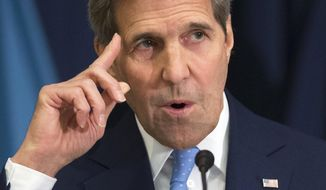 "Secretary of State John Kerry gives a foreign policy speech, Wednesday, Jan. 13, 2016, at National Defense University in Washington. Kerry predicted Iran could comply with last summer's nuclear deal  ""within the next coming days."" (AP Photo/Evan Vucci)"