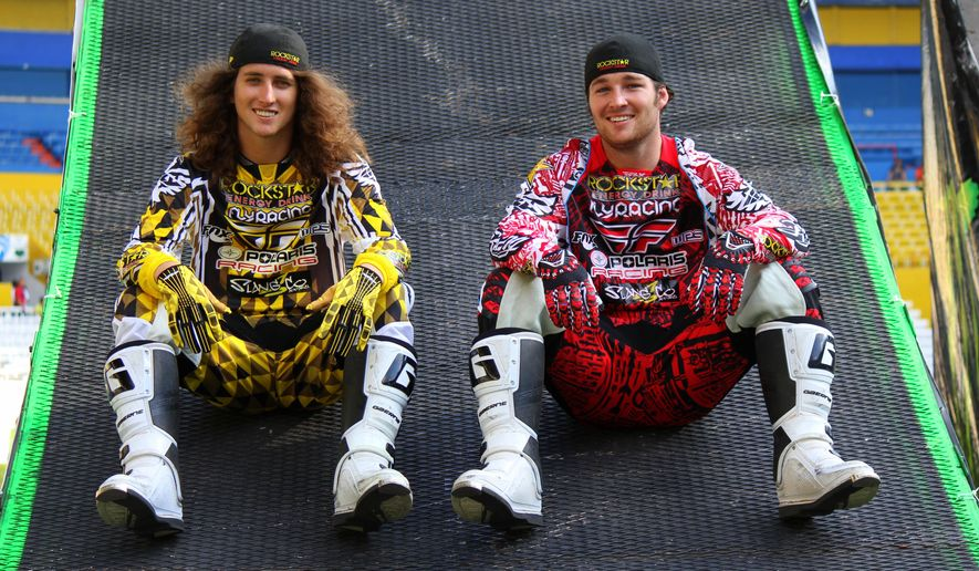 "In this May 26, 2012, photo provided by Rotation Sports Management, Colten and Caleb Moore pose for a photo in Guadalajara, Mexico, where a freestyle motocross event was held.  Caleb Moore died three years ago on Jan. 31 from injuries he sustained in a crash during the snowmobile competition at Winter X in Aspen, Colo. As a tribute to his big brother/best friend/idol/push-the-boundaries training partner, Colten Moore wrote a book with Keith O'Brien entitled, ""Catching the Sky,"" that's available later this week. (BC Vaught/Rotation Sports Management via AP)"