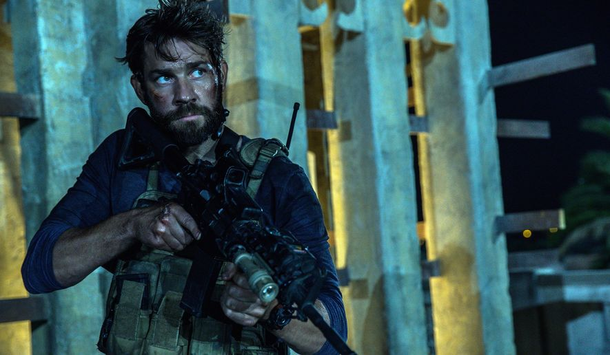 """The new Michael Bay film """"13 Hours,"""" detailing the 2012 siege of the U.S. dipolamtic compound in Benghazi, Libya, continues a wave of conservative-oriented, pro-military films like """"American Sniper."""" (Associated Press)"""