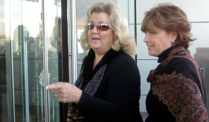 Kathleen Willey (right) and Juanita Broddrick, both of whom accused former President Bill Clinton of sexual misconduct, enter Mr. Clinton's presidential library in Little Rock, Ark., on Oct. 26, 2005. (Associated Press) ** FILE **