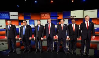 Republican presidential candidates (from left) Ohio Gov. John Kasich, New Jersey Gov. Chris Christie, Sen. Marco Rubio of Florida, businessman Donald Trump, Sen. Ted Cruz of Texas, retired neurosurgeon Ben Carson and former Florida Gov. Jeb Bush take the stage before the Fox Business Network Republican presidential debate Thursday in North Charleston, South Carolina. (Associated Press)