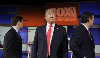 Republican presidential candidate, businessman Donald Trump stands on the stage before the Fox Business Network Republican presidential debate at the North Charleston Coliseum, Thursday, Jan. 14, 2016, in North Charleston, S.C. (AP Photo/Chuck Burton)