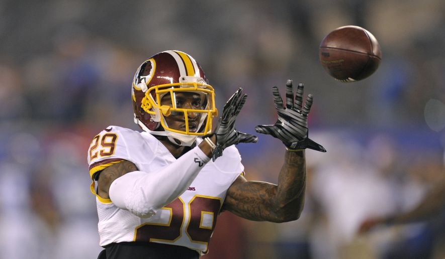 Washington Redskins cornerback Chris Culliver catches a pass before an NFL football game against the New York Giants Thursday, Sept. 24, 2015, in East Rutherford, N.J.  (AP Photo/Bill Kostroun)