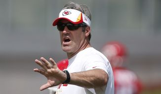 Kansas City Chiefs offensive coordinator Doug Pederson works with quarterbacks during drills at the teams practice facility in Kansas City, Mo., Tuesday, May 21, 2013. (AP Photo/Orlin Wagner)