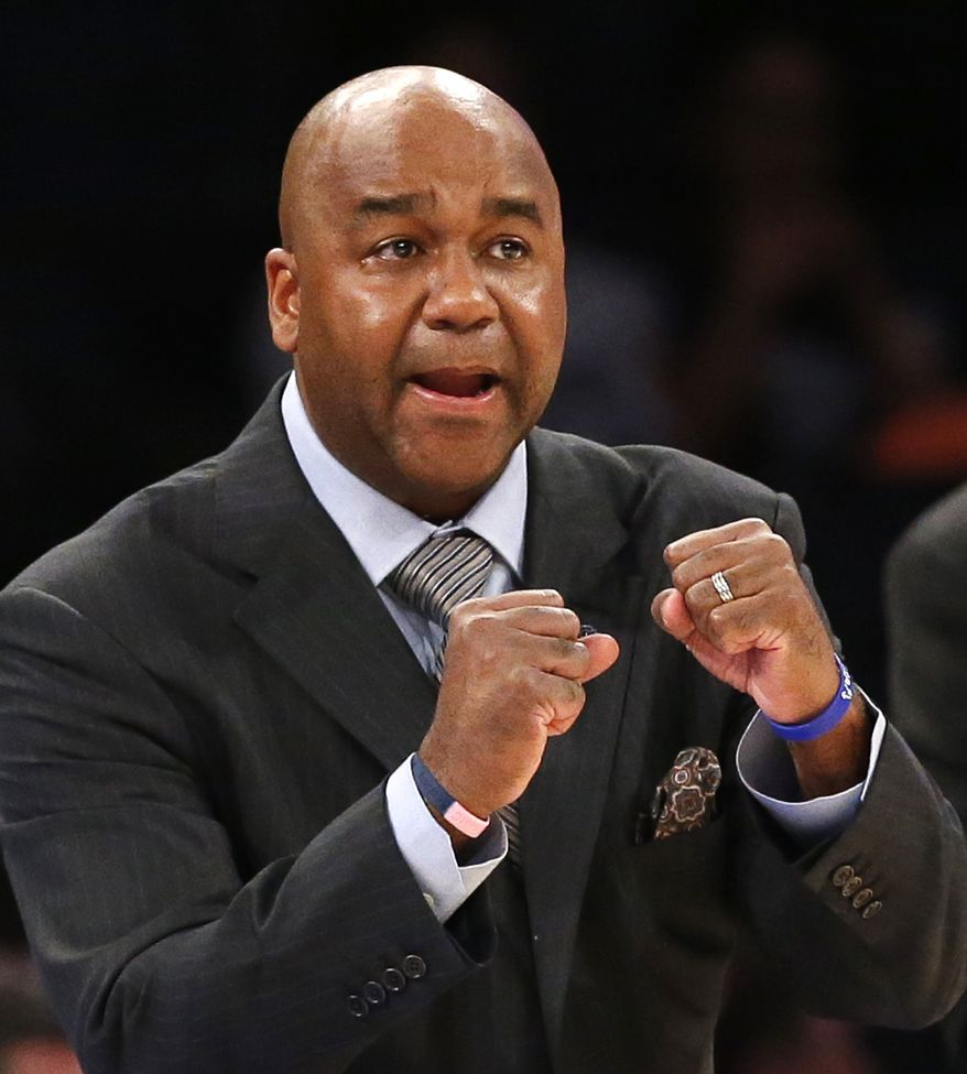 Georgetown head coach John Thompson III gestures to his team in the second half of an NCAA college basketball game against St. John's at Madison Square Garden in New York, Wednesday, Jan. 13, 2016. Georgetown defeated St. Johns 93-73. (AP Photo/Kathy Willens) **FILE**