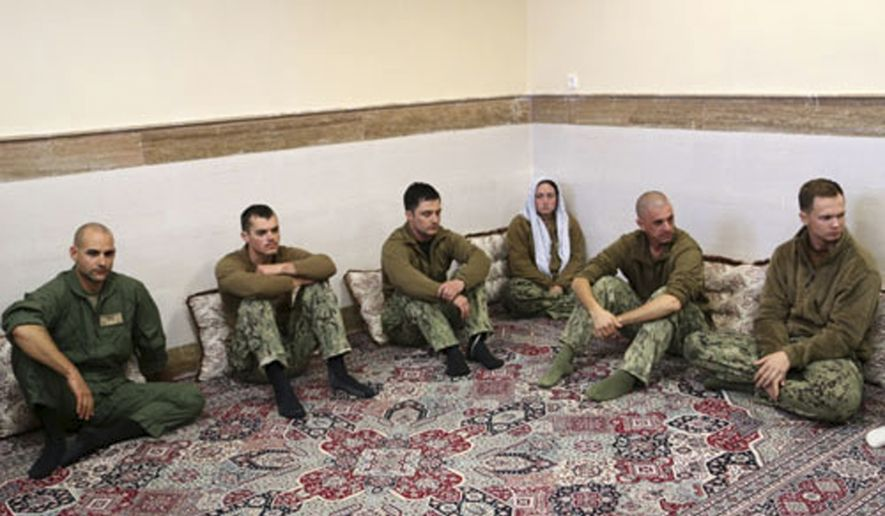 This picture released by the Iranian Revolutionary Guards on Wednesday, Jan. 13, 2016, shows detained American Navy sailors in an undisclosed location in Iran. Less than a day after 10 U.S. Navy sailors were detained in Iran when their boats drifted into Iranian waters, they and their vessels were back safely Wednesday with the American fleet. (Sepahnews via AP)