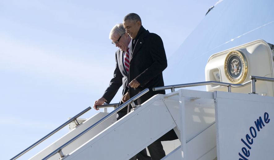President Barack Obama and Rep. Brad Ashford, D-Neb. arrive on Air Force One at Offutt Air Force Base in Bellevue, Neb., Wednesday, Jan. 13, 2016, en route to Omaha, Neb., where the president will speak at University of Nebraska Omaha, and visit with a local family. (AP Photo/Carolyn Kaster)