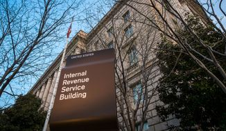 FILE - This April 13, 2014, file photo, shows The Internal Revenue Service (IRS) headquarters building Washington.  (AP Photo/J. David Ake, File)