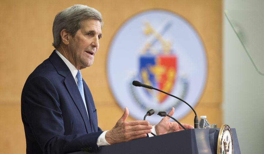 """Secretary of State John Kerry gestures while giving a foreign policy speech, Wednesday, Jan. 13, 2016, at National Defense University in Washington. Kerry predicted Iran could comply with last summer's nuclear deal  """"within the next coming days."""" (AP Photo/Evan Vucci)"""