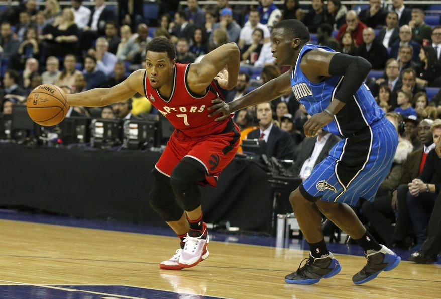 Orlando Magic's Victor Oladipo, right, attempts to block Toronto Raptors guard Kyle Lowry during the second half of an NBA basketball game, at the O2 arena in London, Thursday, Jan. 14, 2016. Raptors won the game 106-103. (AP Photo/Alastair Grant)