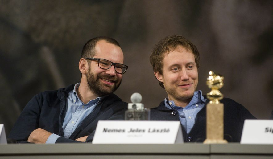 "Hungarian cameraman Matyas Erdely, left, and Hungarian director Laszlo Nemes attend a press conference in Urania National Film Theatre in Budapest, Hungary, Thursday, Jan. 14, 2016, after their movie ""Son of Saul"" was announced among five contenders for the foreign-language Academy Award today.  (Janos Marjai/MTI via AP)"