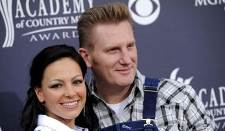 """In this April 3, 2011, photo, Joey Martin Feek, left, and Rory Lee Feek of """"Joey + Rory"""" arrive at the 46th Annual Academy of Country Music Awards in Las Vegas, Nev. (AP Photo/Chris Pizzello, File)"""