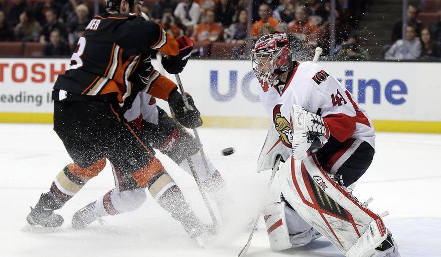 Ottawa Senators goalie Craig Anderson, right, blocks a shot by Anaheim Ducks defenseman Clayton Stoner during the second period of an NHL hockey game in Anaheim, Calif., Wednesday, Jan. 13, 2016. (AP Photo/Chris Carlson)