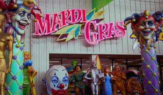 This photo taken Jan. 6, 2010 shows the entrance to Mardi Gras World located in a  300,000-square-foot facility where visitors can view actual Mardi Gras floats and watch as Mardi Gras workers create new additions for the floats in New Orleans. Mardi Gras falls on Feb. 17, 2016 the day before is Presidents Day and the Saturday before is Valentine's Day. ( AP Photo/Judi Bottoni )