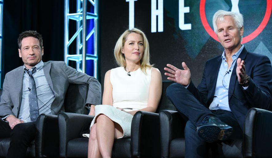 """Actors David Duchovny, from left, Gillian Anderson and creator/executive producer Chris Carter participate in """"The X Files"""" panel at the Fox Winter TCA on Friday, Jan. 15, 2016, Pasadena, Calif. (Photo by Richard Shotwell/Invision/AP)"""