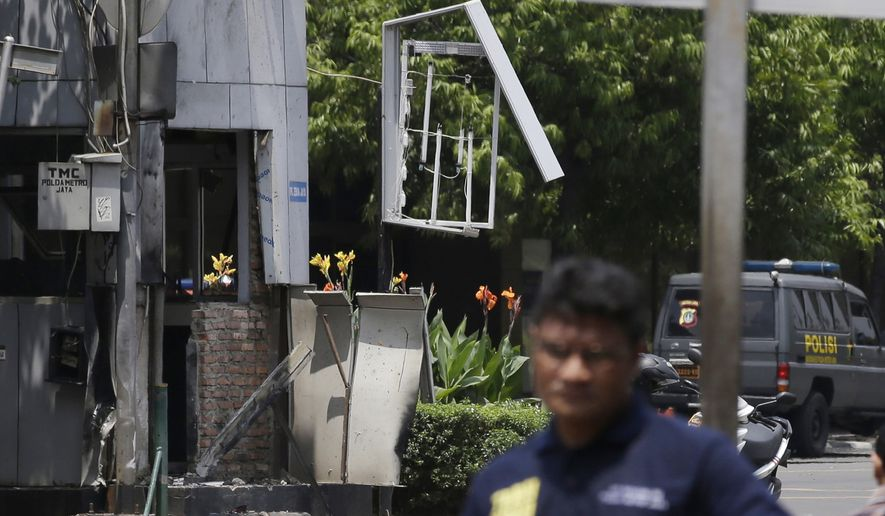 Indonesia Police make line near one of location bomb in Jakarta, Indonesia, Thursday, Jan. 14, 2016. Suicide bombers exploded themselves in downtown Jakarta on Thursday while gunmen attacked a police post nearby, a witness told The Associated Press. Local television reported more explosions in other parts of the city. (AP Photo/Achmad Ibrahim)