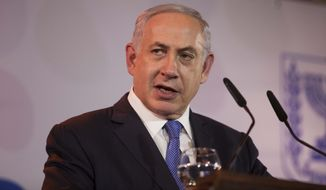 "Israeli Prime Minister Benjamin Netanyahu speaks during his annual address to the foreign media, in Jerusalem, Thursday, Jan. 14, 2016. Israel's prime minister says Sweden's foreign minister's call for a probe into the deaths of Palestinian attackers is ""absurd"" and ""unjust.""  (AP Photo/Dan Balilty)"