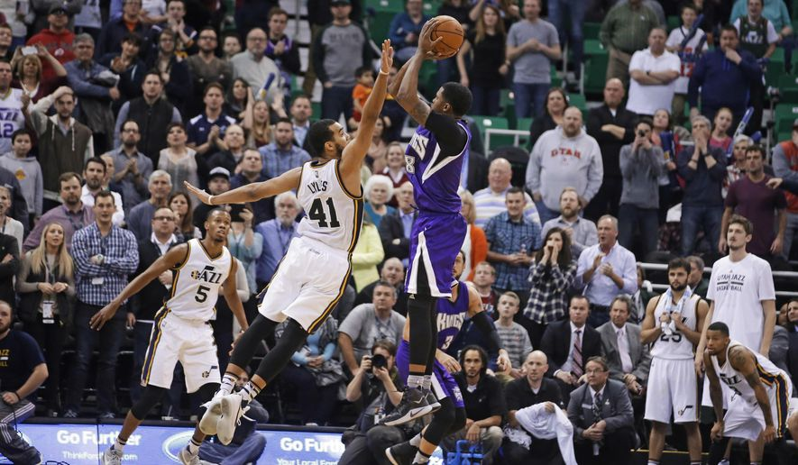 Sacramento Kings forward Rudy Gay (8) shoots the winning basket against Utah Jazz forward Trey Lyles (41) during the finals seconds of an NBA basketball game Thursday, Jan. 14, 2016, in Salt Lake City. The Kings won 103-101. (AP Photo/Rick Bowmer)