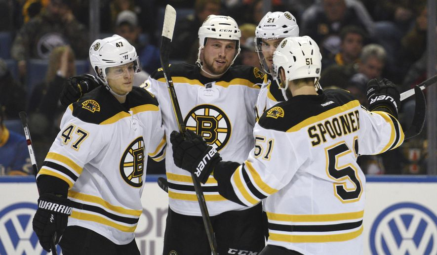 Boston Bruins' Torey Krug (47), Matt Beleskey (39), Loui Ericsson (21) and Ryan Spooner (51) celebrate a goal by Beleskey during the second period of an NHL hockey game against the Buffalo Sabres, Friday, Jan. 15, 2016, in Buffalo, N.Y. (AP Photo/Gary Wiepert)