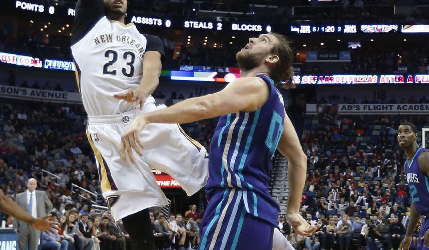 New Orleans Pelicans forward Anthony Davis (23) shoots over Charlotte Hornets forward Spencer Hawes (00) during the first half of an NBA basketball game in New Orleans, Friday, Jan. 15, 2016. (AP Photo/Gerald Herbert)