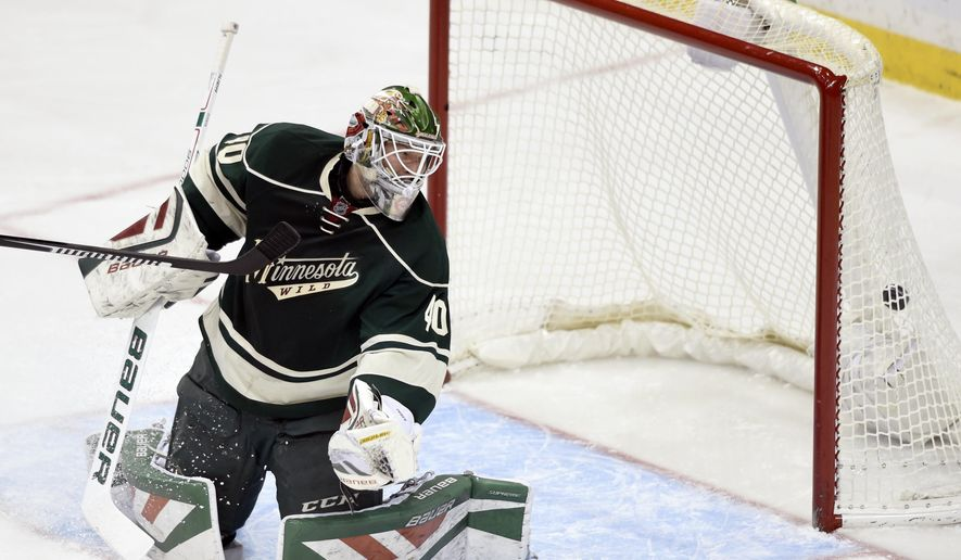 Minnesota Wild goalie Devan Dubnyk (40) watches a shot by Winnipeg Jets right wing Blake Wheeler enter the net for a goal during the first period of an NHL hockey game Friday, Jan. 15, 2016, in St. Paul, Minn. (AP Photo/Hannah Foslien)