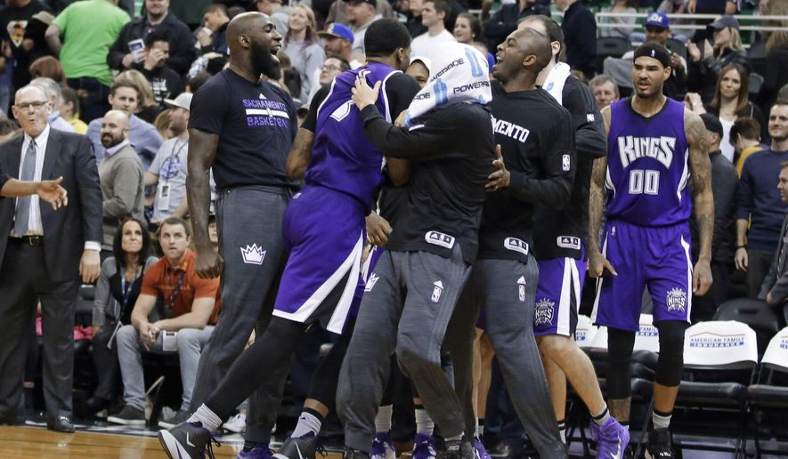 Sacramento Kings forward Rudy Gay, second from left, celebrates with teammates after scoring the winning basket against the Utah Jazz in an NBA basketball game Thursday, Jan. 14, 2016, in Salt Lake City. The Kings won 103-101. (AP Photo/Rick Bowmer)