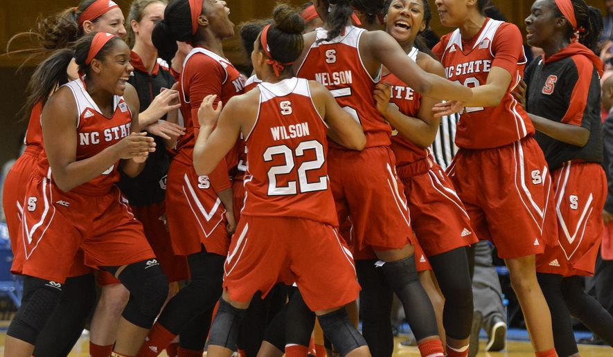 North Carolina State celebrates a 65-52 win over No. 22 Duke during an NCAA college basketball game Thursday, Jan. 14, 2016, in Durham, N.C. (Bernard Thoms/The Herald-Sun via AP) Mandatory Credit