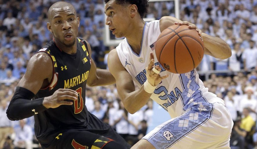 FILE - In this Dec. 1, 2015, file photo, North Carolina's Marcus Paige drives as Maryland's Rasheed Sulaimon (0) defends during the first half of an NCAA college basketball game in Chapel Hill, N.C. Paige is averaging 15.1 points on a career-high 47 percent shooting entering Saturday's game against North Carolina State. (AP Photo/Gerry Broome, File)
