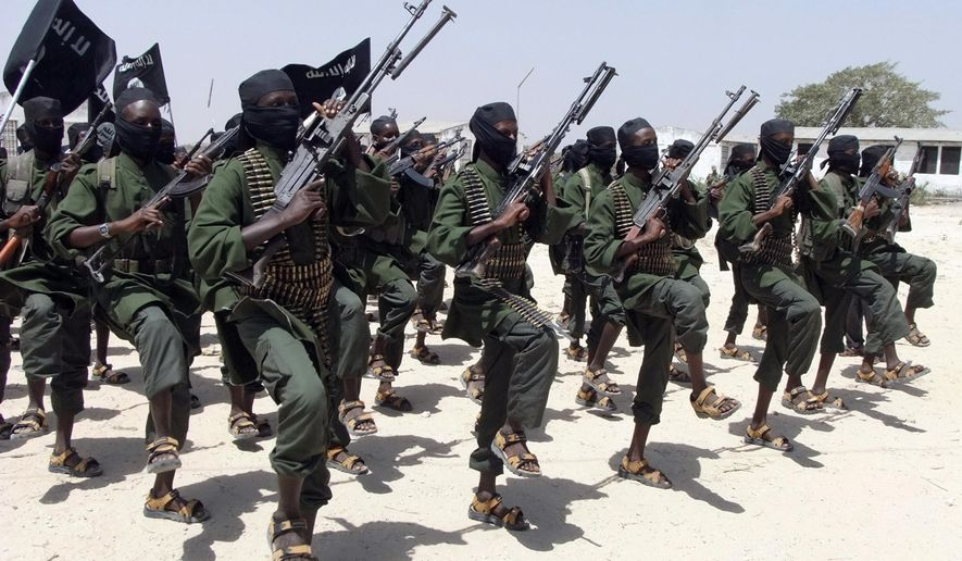 In this Thursday, Feb. 17, 2011 file photo, hundreds of newly trained al-Shabab fighters perform military exercises in the Lafofe area, some 18 kilometers (11 miles) south of Mogadishu, in Somalia. (AP Photo/Farah Abdi Warsameh, File)