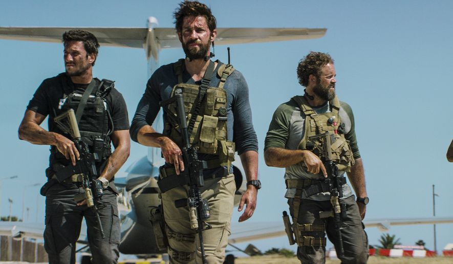 """This photo provided by Paramount Pictures shows Pablo Schreiber, from left, as Kris """"Tanto"""" Paronto, John Krasinski as Jack Silva, David Denman as Dave """"Boon"""" Benton and Dominic Fumusa as John """"Tig"""" Tiegen, in the film, """"13 Hours: The Secret Soldiers of Benghazi"""" from Paramount Pictures and 3 Arts Entertainment/Bay Films. The movie releases in U.S. theaters Jan. 15, 2016. (Christian Black/Paramount Pictures via AP)"""