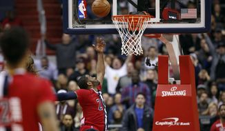 Washington Wizards guard John Wall (2) misses a last second shot in the second half of an NBA basketball game against the Boston Celtics, Saturday, Jan. 16, 2016, in Washington. The Celtics won 119-117. (AP Photo/Alex Brandon)
