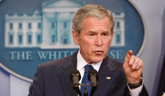 President George W. Bush gestures during a news conference at the White House in Washington on Jan. 12, 2009. (Associated Press) **FILE**