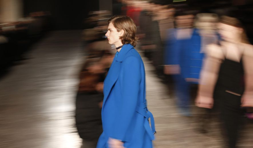 Models wear creations for Costume National Homme men's Fall-Winter 2016-2017 collection, part of the Milan Fashion Week, unveiled in Milan, Italy, Saturday, Jan. 16, 2016. (AP Photo/Antonio Calanni)
