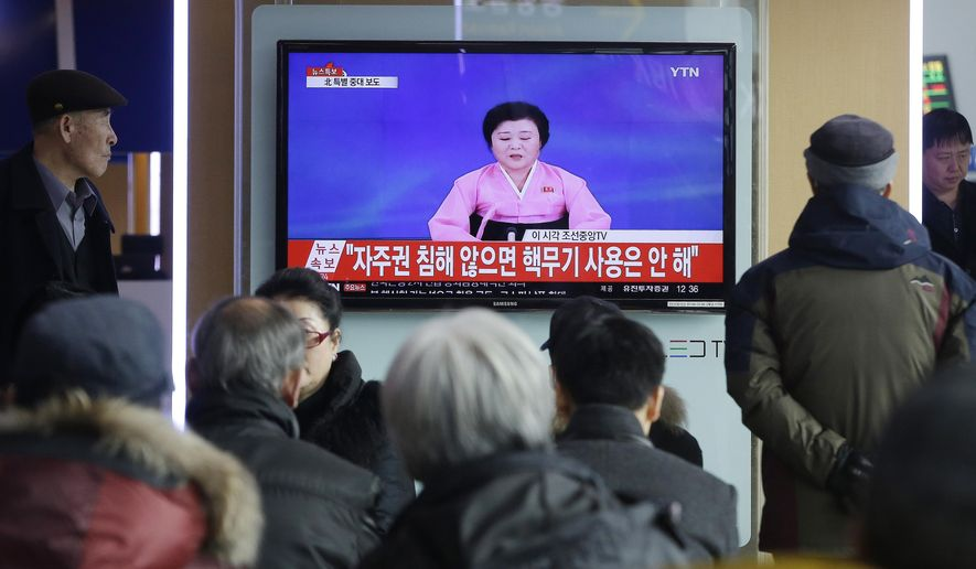 In this Wednesday, Jan. 6, 2016, file photo, people watch a TV news program showing North Korea's announcement, at the Seoul Railway Station in Seoul, South Korea. (AP Photo/Ahn Young-joon, File)
