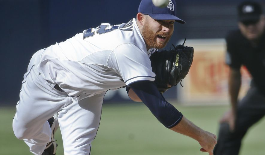 FILE - In this Oct. 1, 2015, file photo, San Diego Padres starting pitcher Ian Kennedy works against the Milwaukee Brewers in the first inning of a baseball game, in San Diego. A person familiar with the situation says the Kansas City Royals and pitcher Ian Kennedy have agreed to a $70 million, five-year contract that includes an opt-out after the first two years. The person spoke to The Associated Press on condition of anonymity Saturday, Jan. 16, 2016,  because the deal will not be finalized until the 31-year-old Kennedy passes a physical. (AP Photo/Lenny Ignelzi, File)