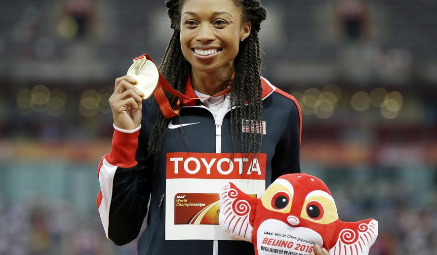 FILE - In this Friday, Aug. 28, 2015 file photo, Women's 400m gold medalist United States' Allyson Felix celebrates on the podium at the World Athletics Championships at the Bird's Nest stadium in Beijing. Track's governing body made a scheduling change for the Rio de Janeiro Olympics that will allow American sprinter Allyson Felix to go for gold in both the 200 and 400 meters. It's not unprecedented. In 1996, the schedule was changed so American Michael Johnson could go for the 200-400 double. He won gold in both. (AP Photo/Kin Cheung, File)