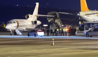 Homecoming: A U.S. government plane met with a Dassault Falcon of the Swiss army air force at Geneva airport in Switzerland to bring back to the U.S. American hostages who were recently freed from lengthy imprisonments in Iran. (Associated Press)