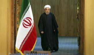 Iranian President Hassan Rouhani arrives for a news conference in Tehran, Iran, Sunday, Jan. 17, 2016. The implementation of a historic nuclear deal with world powers is expected to pave the way for a new economic reality in Iran, now freed from harsh international sanctions. On Sunday Rouhani presented parliament with a draft budget that plans for an economic windfall even as it reduces reliance on oil revenues. (AP Photo/Ebrahim Noroozi)