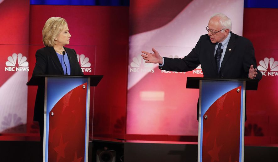 Democratic presidential candidate Sen. Bernard Sanders gestures toward Hillary Clinton during the Democratic presidential debate Sunday at the Gaillard Center in Charleston, S.C. (Associated Press)
