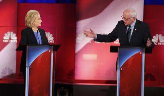 Democratic presidential candidate Sen. Bernard Sanders gestures toward Hillary Clinton during the Democratic presidential debate Sunday at the Gaillard Center in Charleston, S.C. (Associated Press)