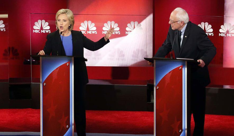 Hillary Clinton gestures toward Sen. Bernard Sanders during the Democratic presidential debate Sunday in Charleston, S.C. (Associated Press)