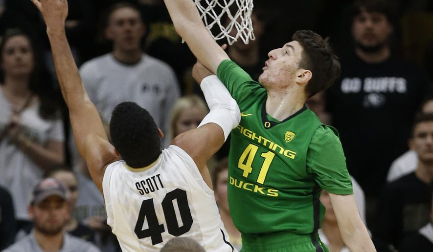Colorado's Josh Scott (40) takes a shot covered by Oregon's Roman Sorkin (41) during the first half of an NCAA college basketball game, in Boulder, Colo., Sunday, Jan. 17, 2016. (AP Photo/Brennan Linsley)