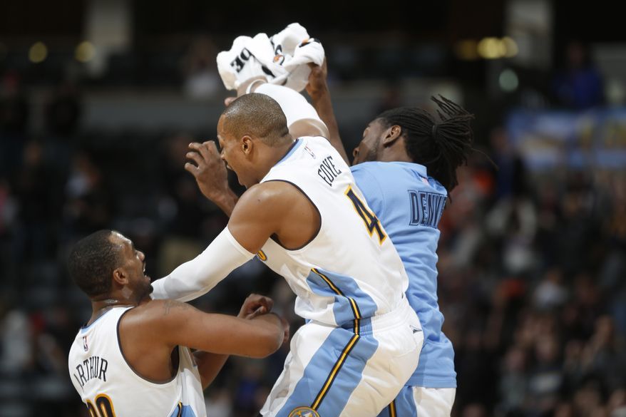 Denver Nuggets guard Randy Foye, center, celebrates hitting a three-point basket with teammates Darrll Arthur, left, and Kenneth Faried against the Indiana Pacers late in the second half of an NBA basketball game, Sunday, Jan. 17, 2016, in Denver. The Nuggets won 129-126. (AP Photo/David Zalubowski)