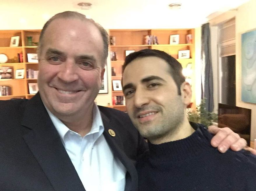 LED IN: In a Monday, Jan. 18, 2016 photo provided by the Hekmati family, U.S. Rep. Dan Kildee, D-Flint Township, Mich., meets with former Iran prisoner Amir Hekmati at Landstuhl Regional Medical Center in Landstuhl, Germany. Hekmati was detained in August 2011 on espionage charges. Kildee told reporters that he's been working to free Hekmati and couldn't wait to meet him in person. (Courtesy of the Hekmati Family via AP) (Associated Press)