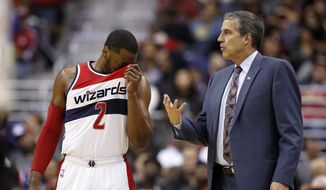 Washington Wizards guard John Wall (2) listens to head coach Randy Wittman in the second half of an NBA basketball game against the Portland Trail Blazers, Monday, Jan. 18, 2016, in Washington. The Trail Blazers won 108-98. (AP Photo/Alex Brandon)